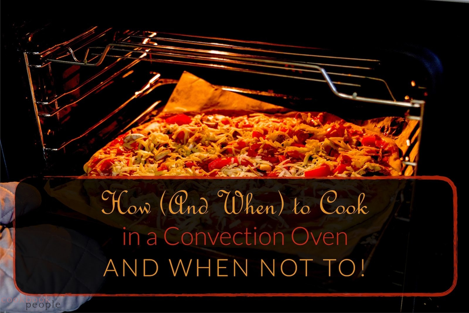Oven-gloved hand removing pizza from hot oven with title: How (And When) to Cook in a Convection Oven - and When Not To!