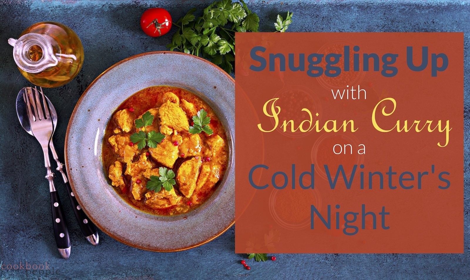 """Plate of chicken curry with tomato and coriander on blue bakckground overlaid with text """"Snuggling Up with Indian Curry on a Cold Winter's Night"""""""